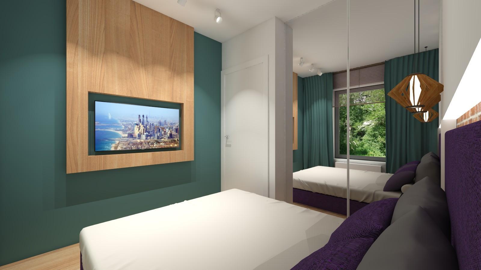 malutka-sypialnia-z-chlodnym-odcieniem-zieleni-na-scianie.jpg