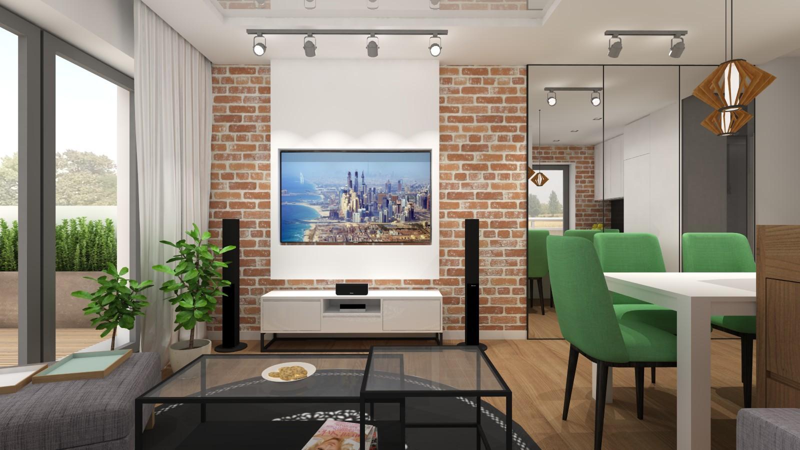 nowoczesny-salon-w-stylu-loftowym-z-zabudowa-tv-cegla-na-scianie-lustrami-aneksem-kuchennym-zielone-krzesla-w-jadalni